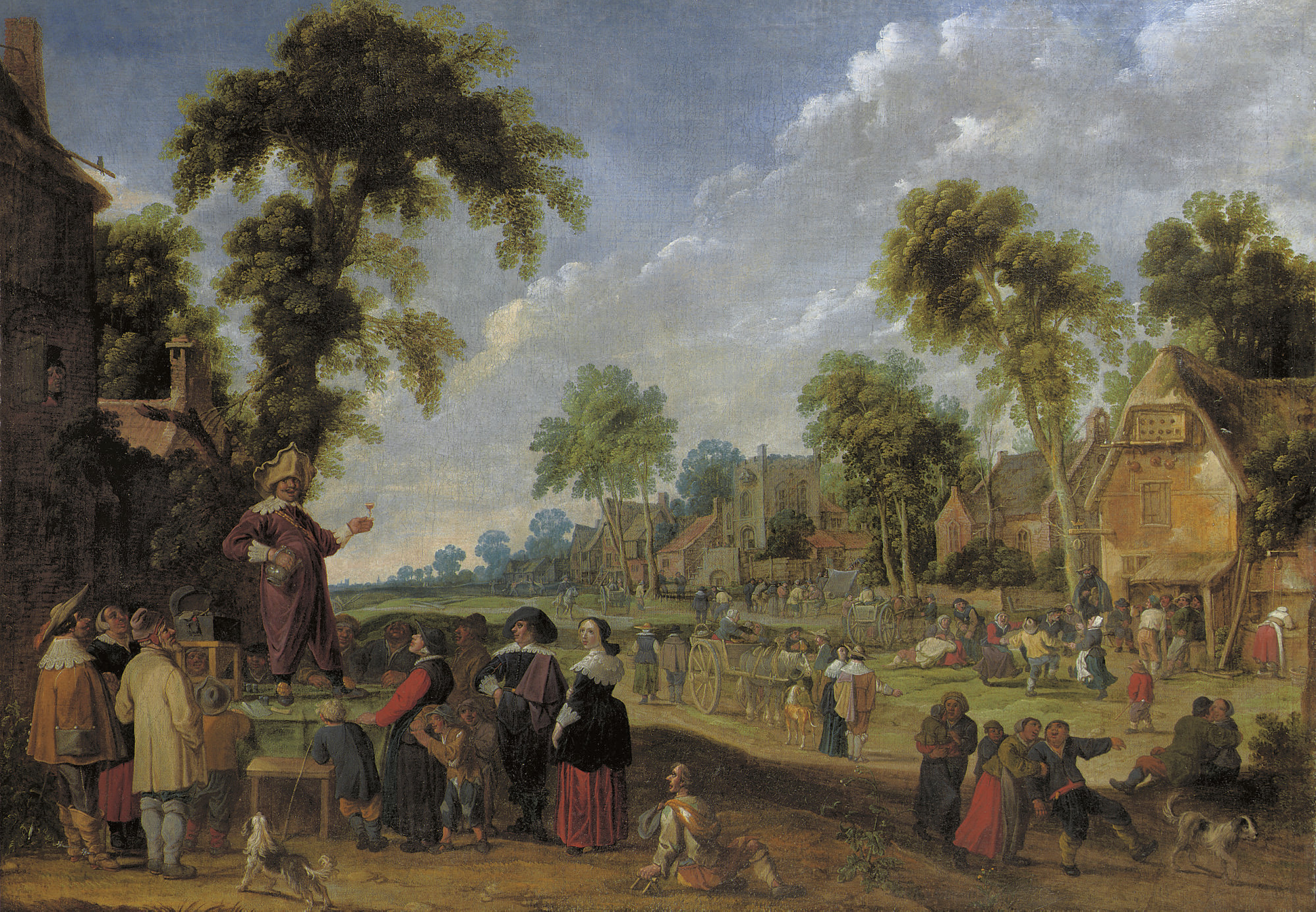 A quack doctor in a village landscape with numerous figures