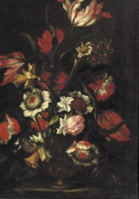 Tulips, roses, narcissi and other flowers in a vase on a ledge