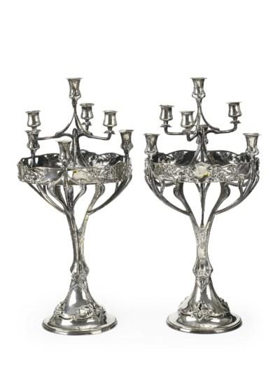 A pair of silver seven-light J