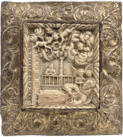 A CARVED ALABASTER RELIEF OF T