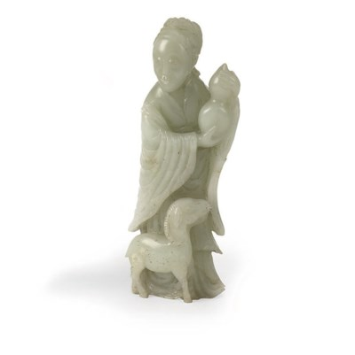 A Chinese jade figure of a lad