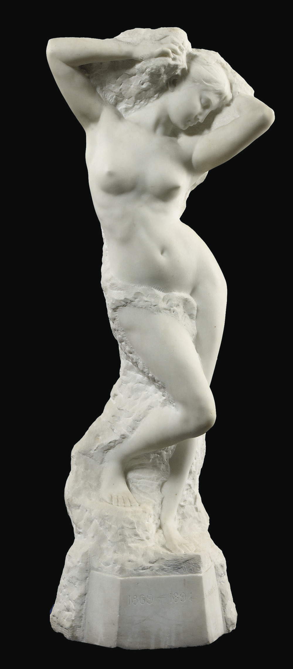 A FRENCH CARVED WHITE MARBLE FIGURE OF A FEMALE NUDE 'VOLUBILIS'
