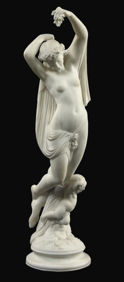 A CARVED MARBLE GROUP OF A FEM