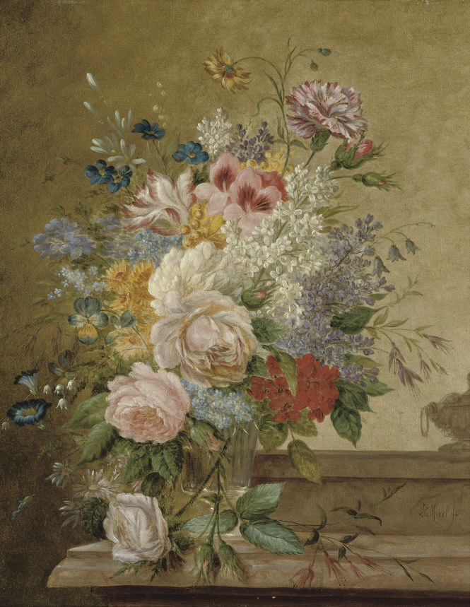 A bouquet of flowers in a glass vase on a ledge