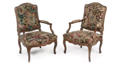 A pair of Louis XV walnut faut