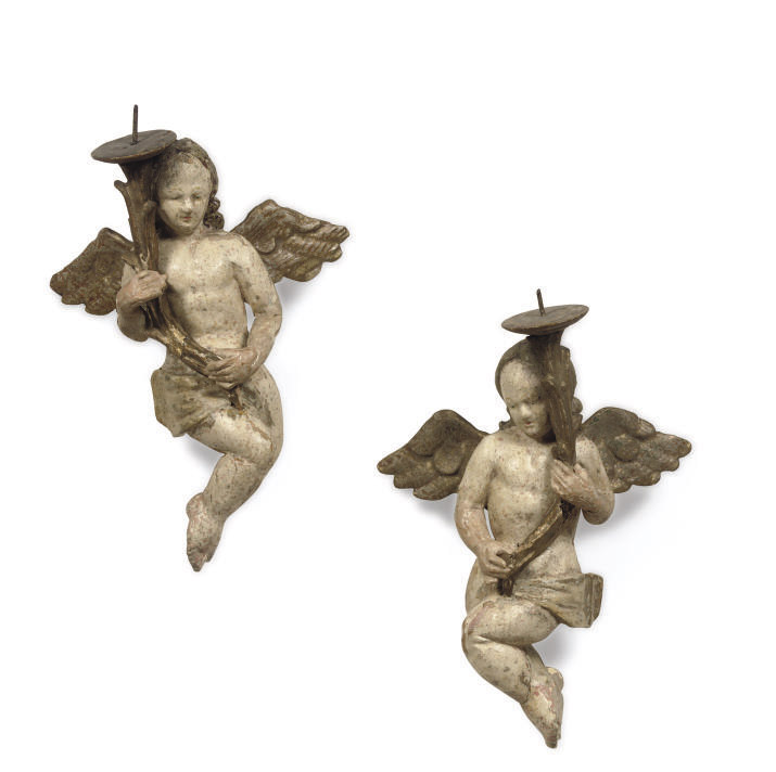 A pair of parcel-gilt and poly