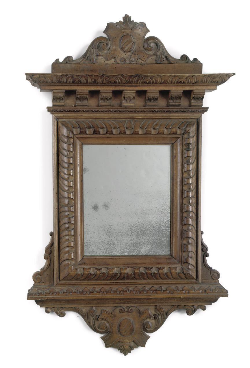 An Italian walnut mirror