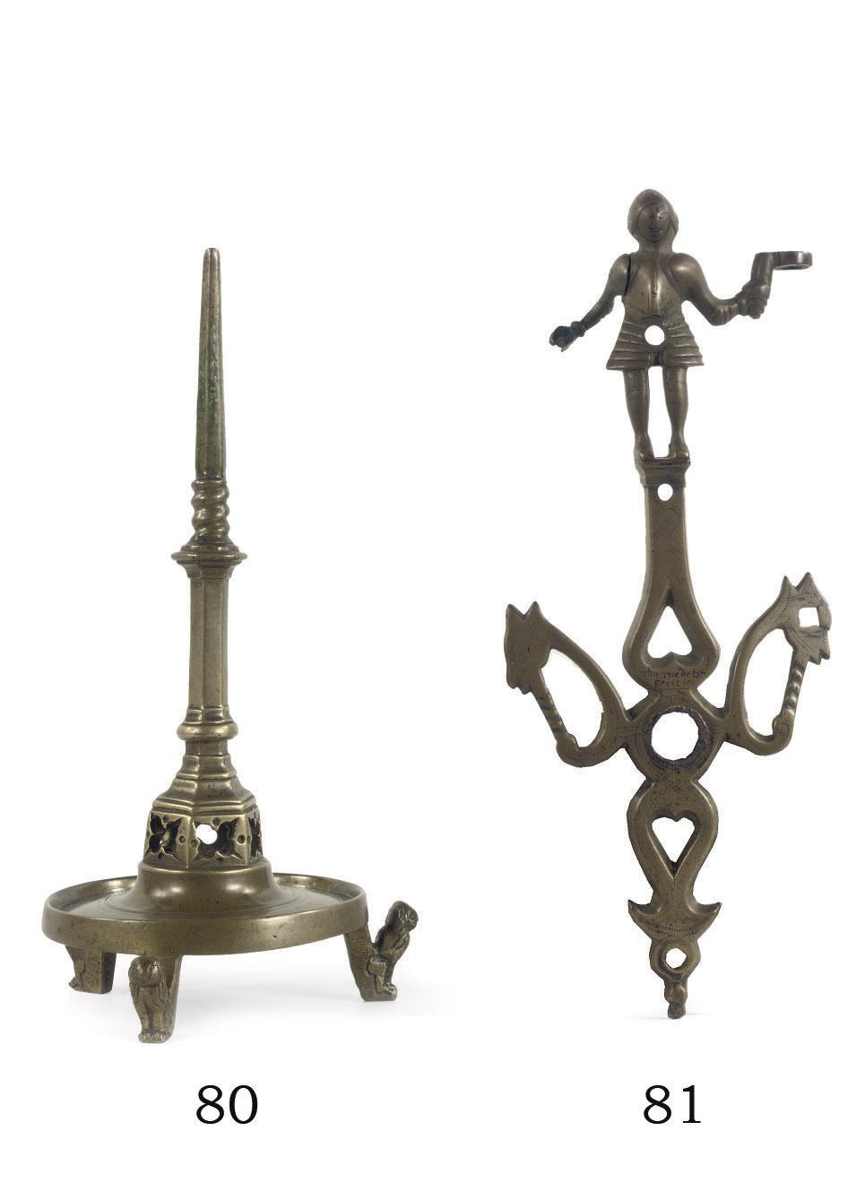 A brass figural ornament or fi