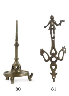 A brass figural ornament or fi