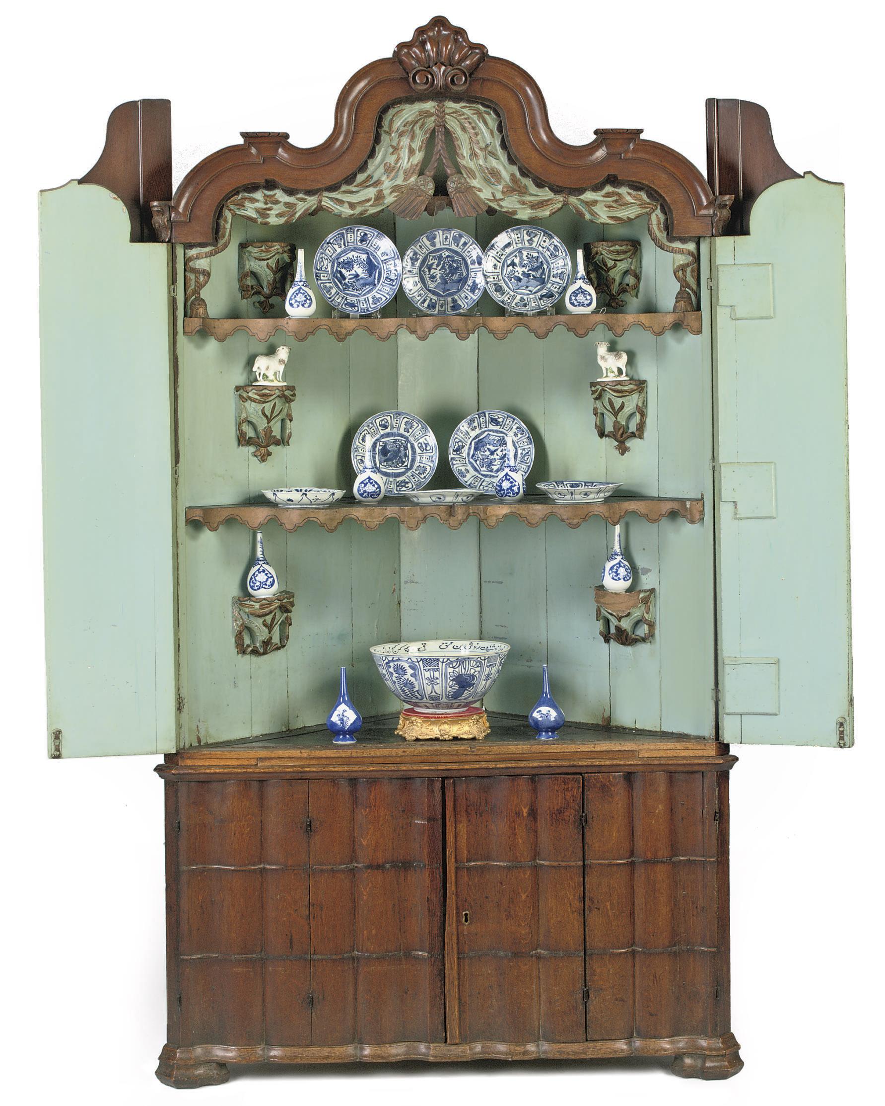 A Dutch oak corner cabinet
