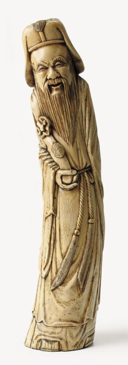 A Chinese ivory figure of Shou