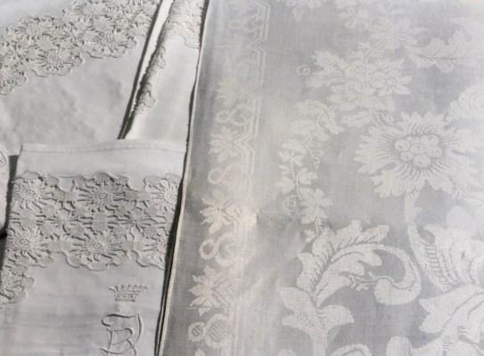 Five damask linen tablecloths