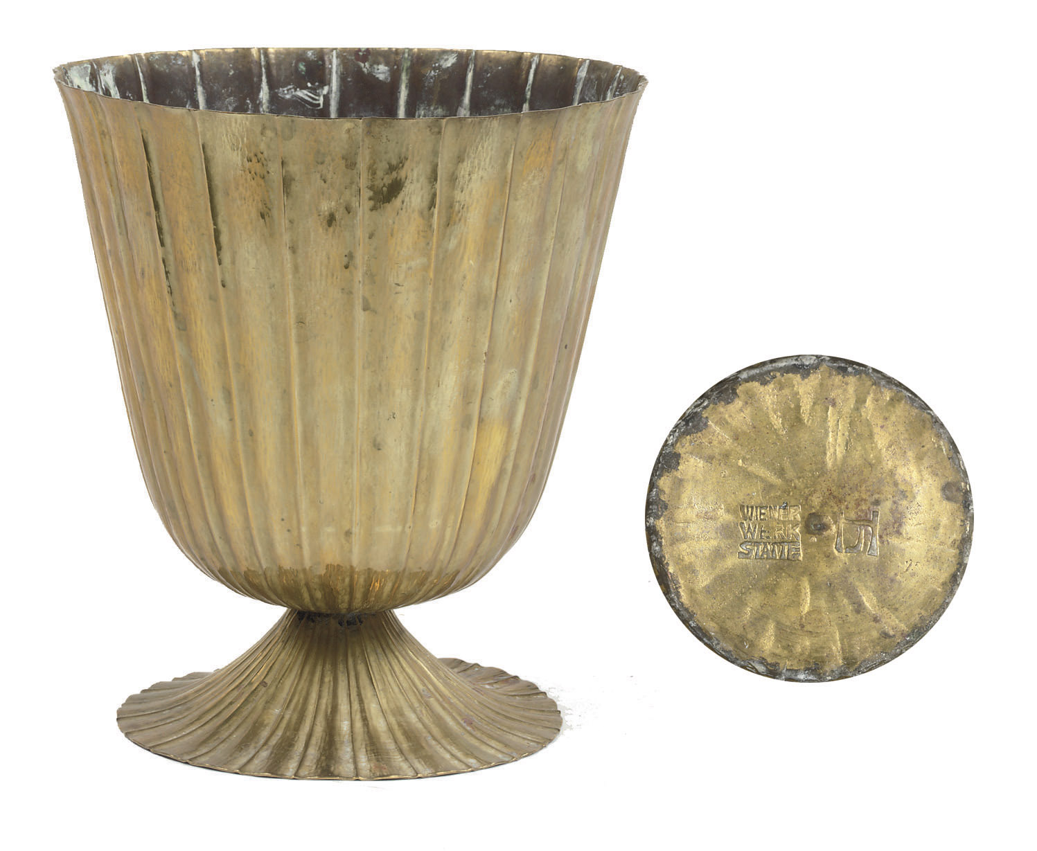 A HAMMERED BRASS VASE