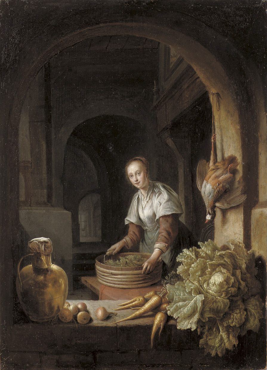 A maid preparing vegetables in a kitchen