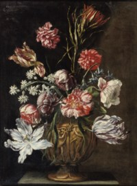 Tulips, marigolds and other flowers in a sculpted vase on a stone ledge