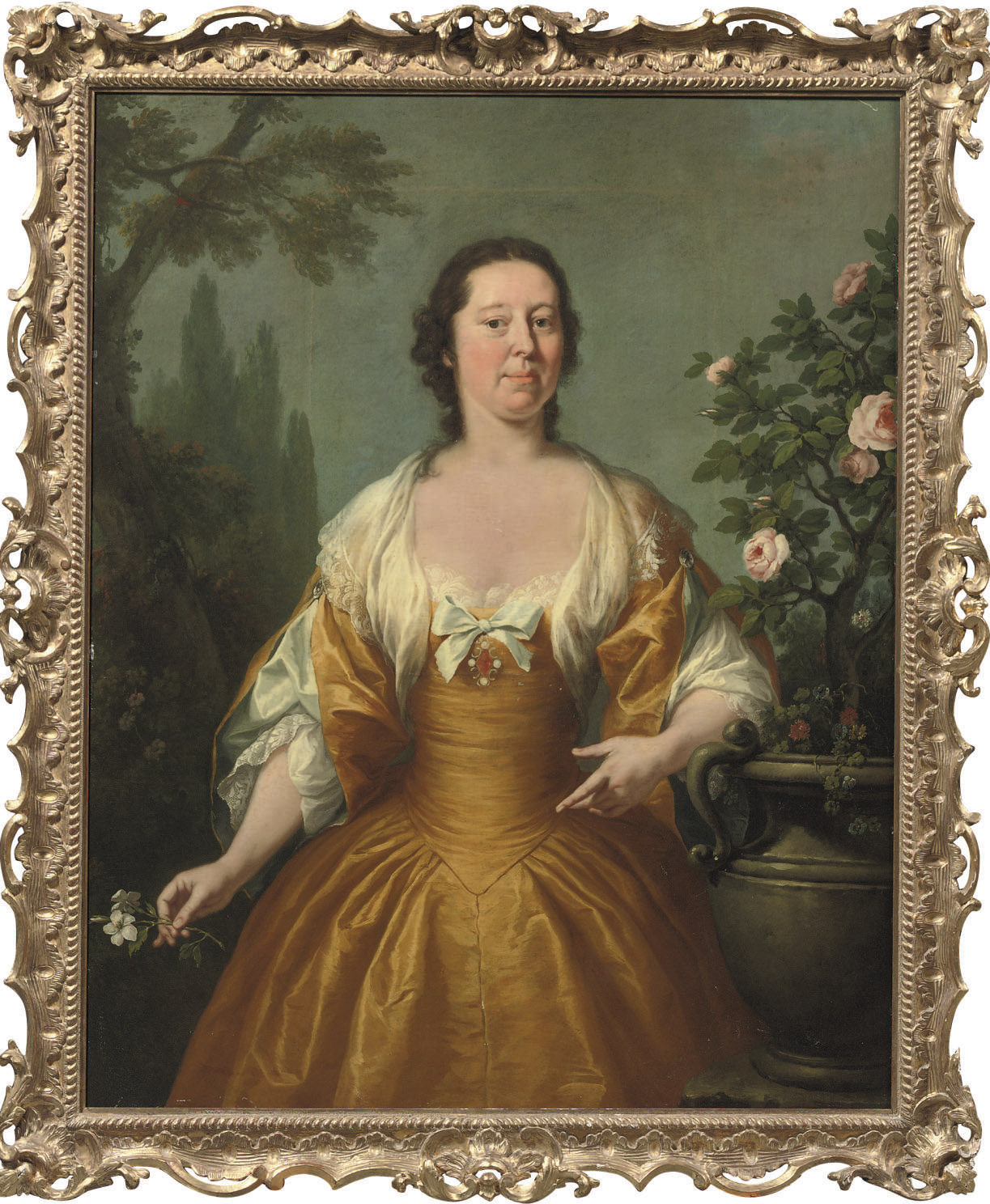 Portrait of a lady, three-quarter-length, in a yellow dress with white frills, holding a flower, in a landscape
