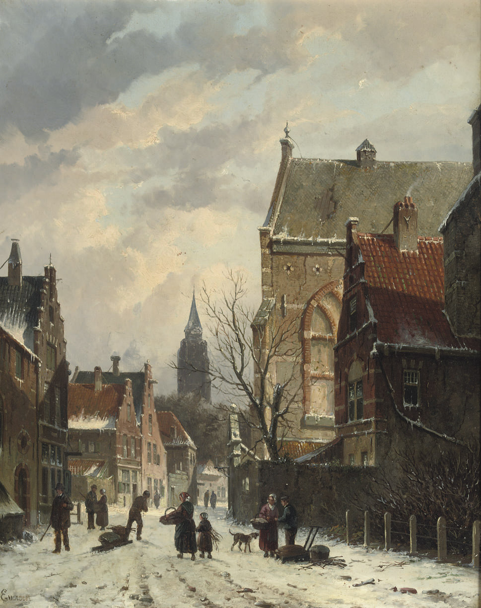 A snow-covered street with a church beyond