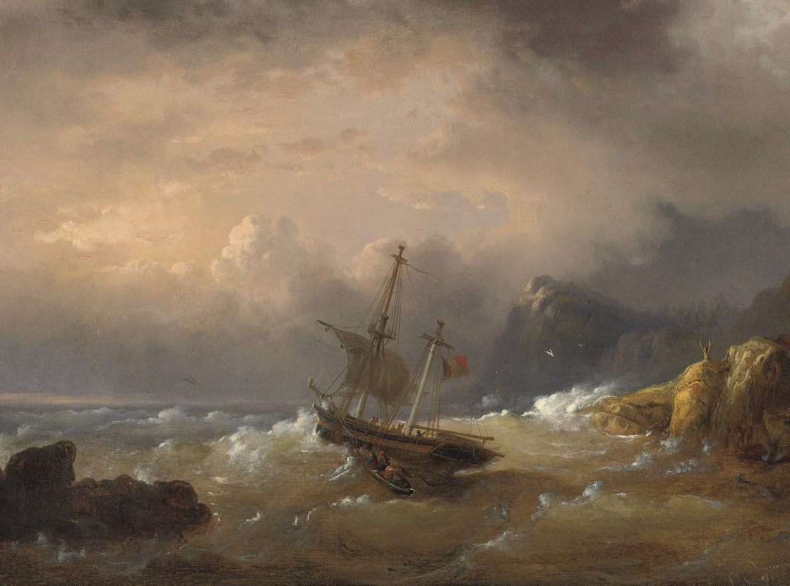 A sailing vessel off a rocky coast
