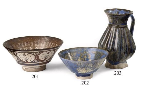 A Kashan blue pottery jug