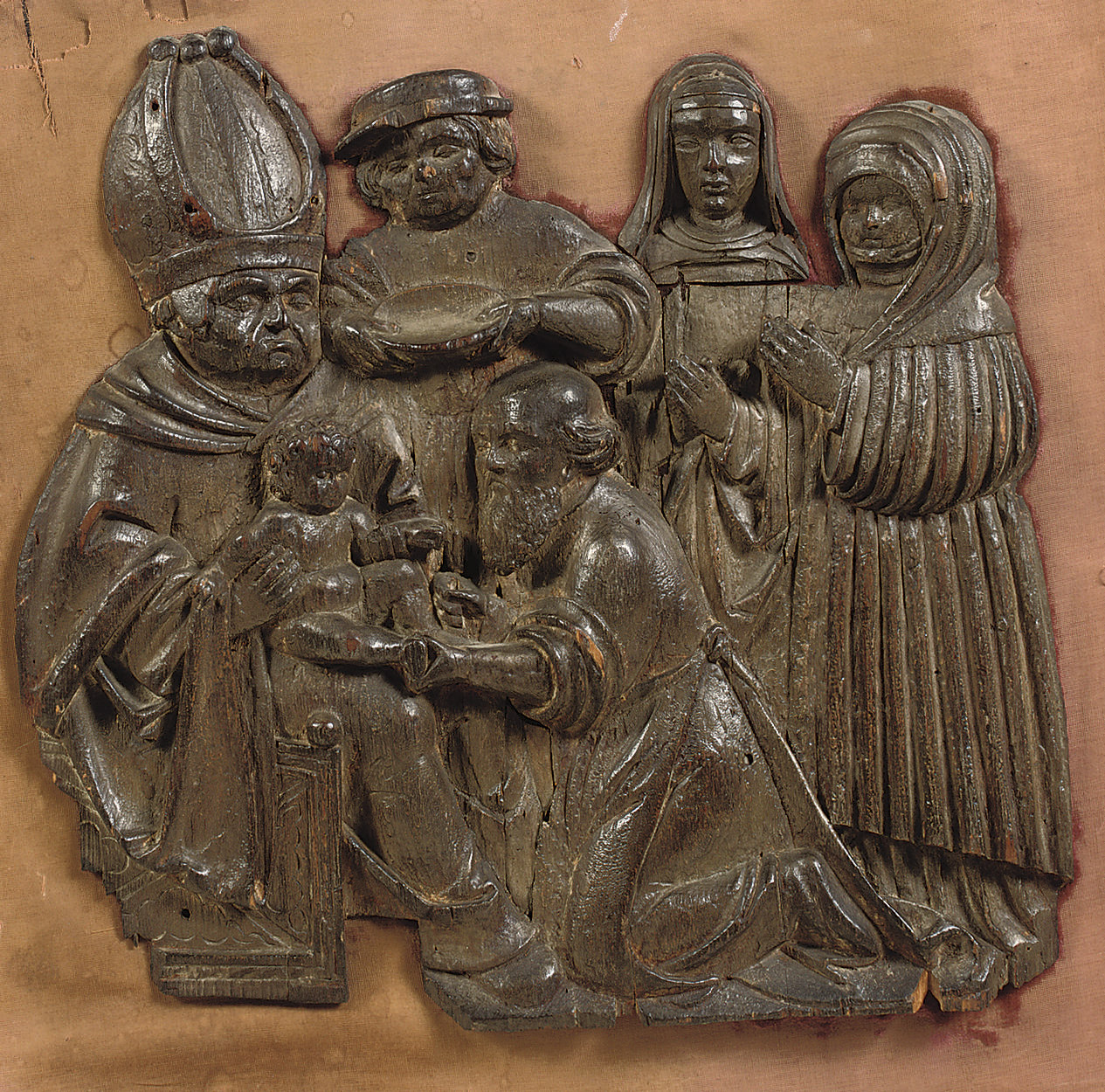 a carved wood relief of the ci