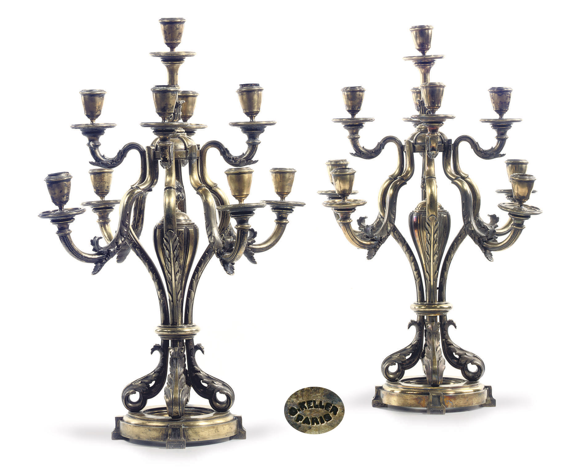 A pair of French silver nine-light candelabra