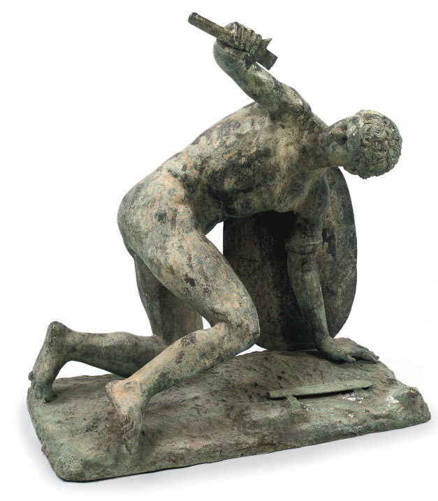 A BRONZE FIGURE OF A DEFEATED
