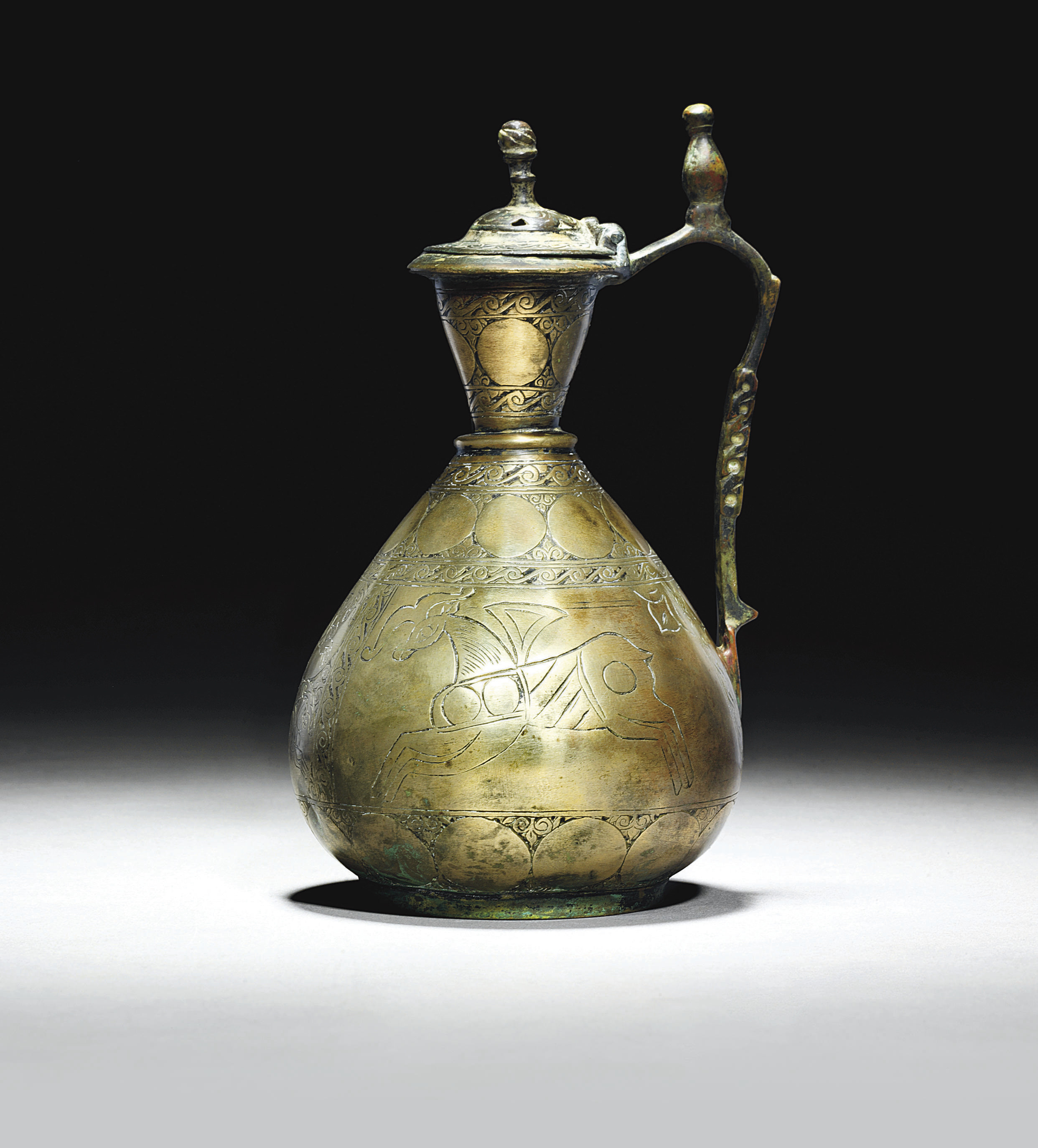 AN EARLY ISLAMIC HIGH TIN BRON