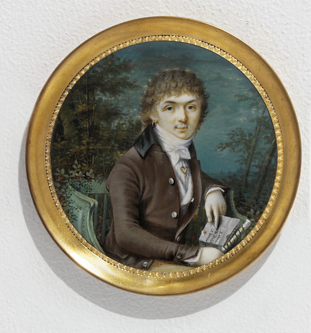 A boy, in brown coat with black collar, light brown trousers, white waistcoat, shirt and knotted cravat, gold heart-shaped tie-pin, gold earring, seated on a green wooden chair holding a letter in his left hand and a cane in his right hand; landscape and sky background