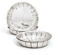 A SET OF FOUR GEORGE I SILVER STRAWBERRY-DISHES