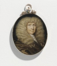 A gentleman, in brown satin draped gown, Venetian lace cravat, lightly powdered curling periwig