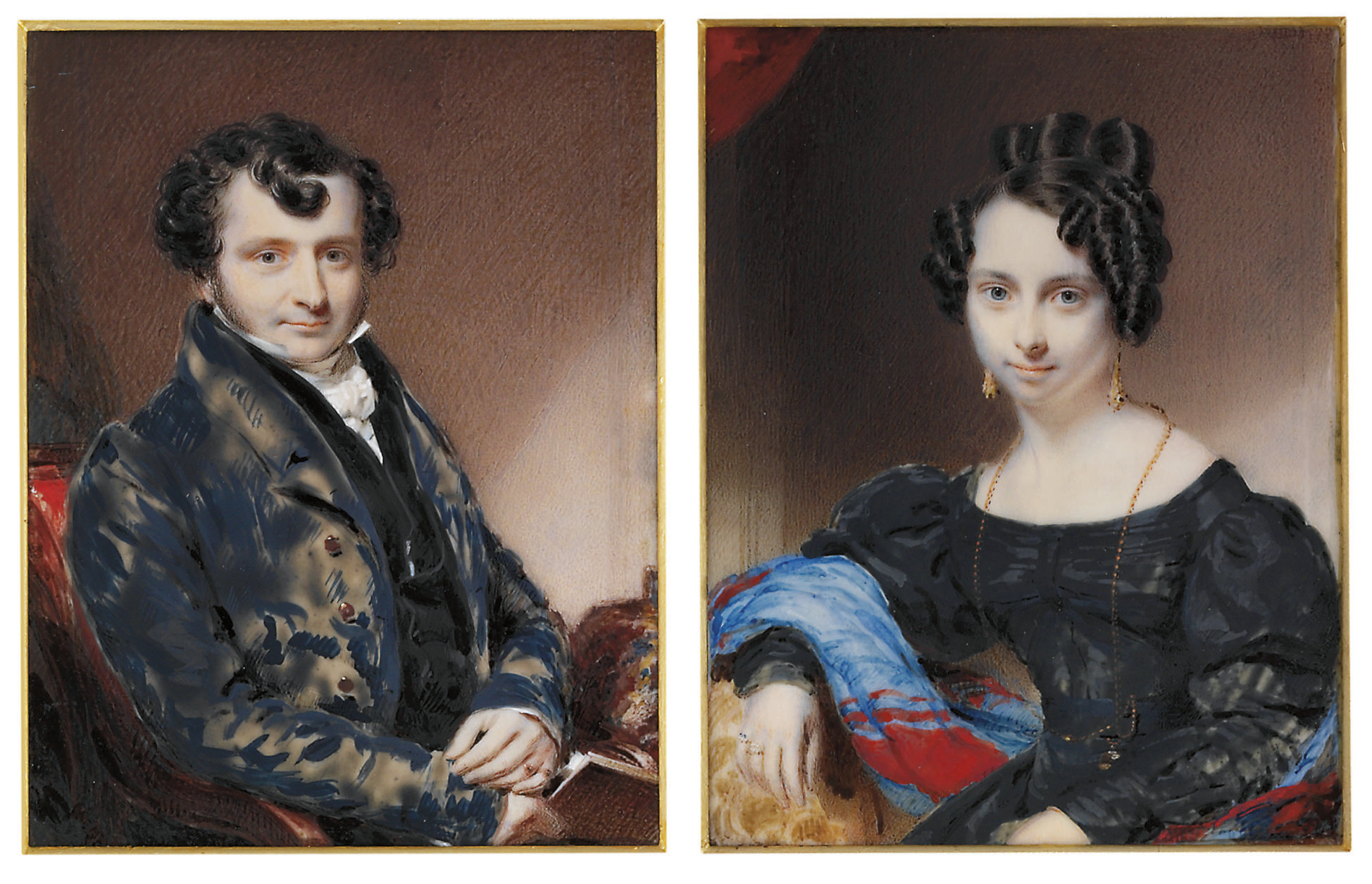A pair of miniatures: a young gentleman, in blue frock coat with brass buttons, black waistcoat, white linen shirt with stand collar, white knotted cravat, two sapphire-set rings, curling dark hair, a book in his right hand; interior background; together with a young lady, in black dress, seated on blue and red shawl, long gold necklace with pendant, drop gold gem-set earrings, gem-set rings on her right hand; dark red velvet curtain background