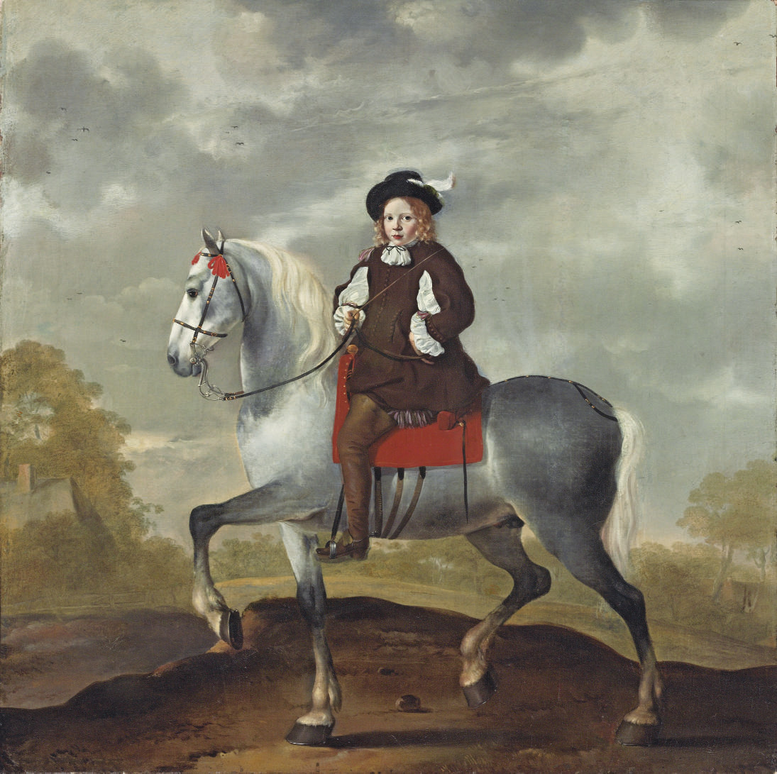 An equestrian portrait of a boy, in brown, on a grey horse by a cottage in a wooded landscape