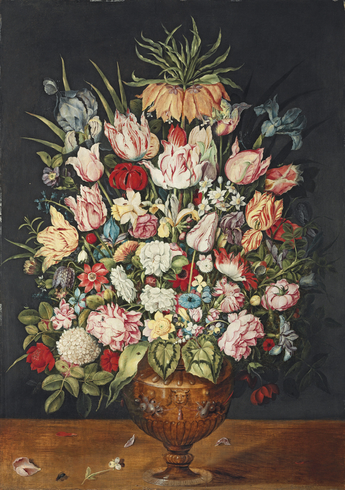 Tulips, roses, a chrysanthemum and other flowers in a sculpted bronze urn, with ladybirds, a moth and other insects, on a wooden table