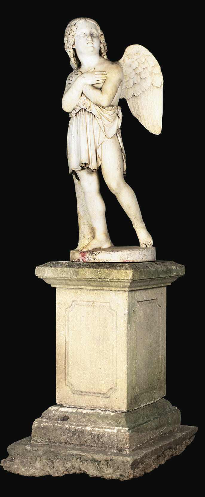 A CARVED MARBLE FIGURE OF CUPI