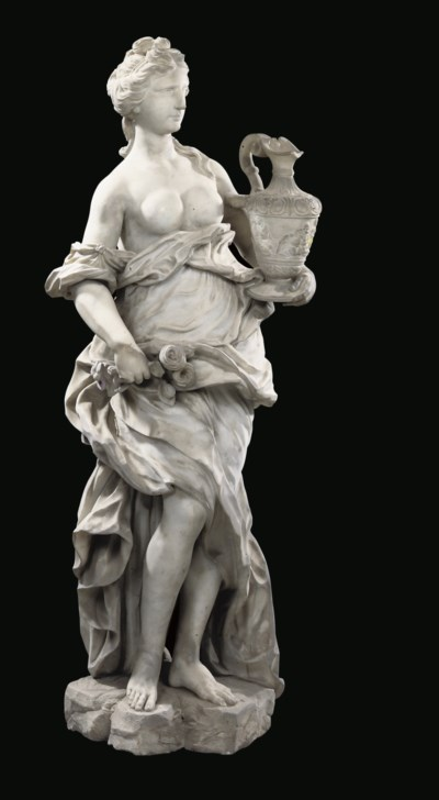 A CARVED MARBLE FIGURE OF HEBE