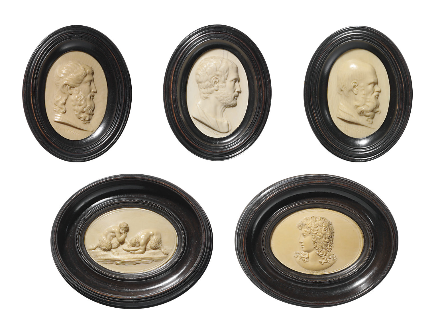 FIVE OVAL CARVED IVORY RELIEFS