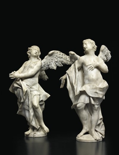 A PAIR OF CARVED MARBLE ANGELS