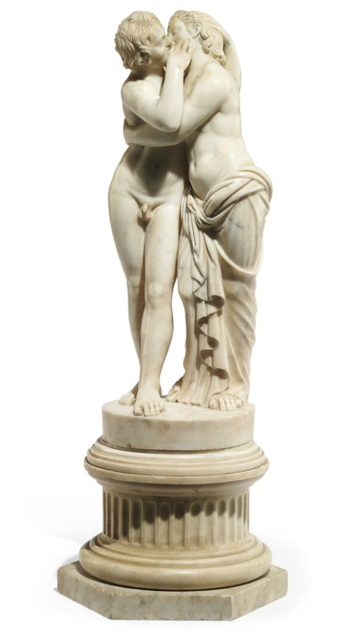 A CARVED MARBLE GROUP OF CUPID