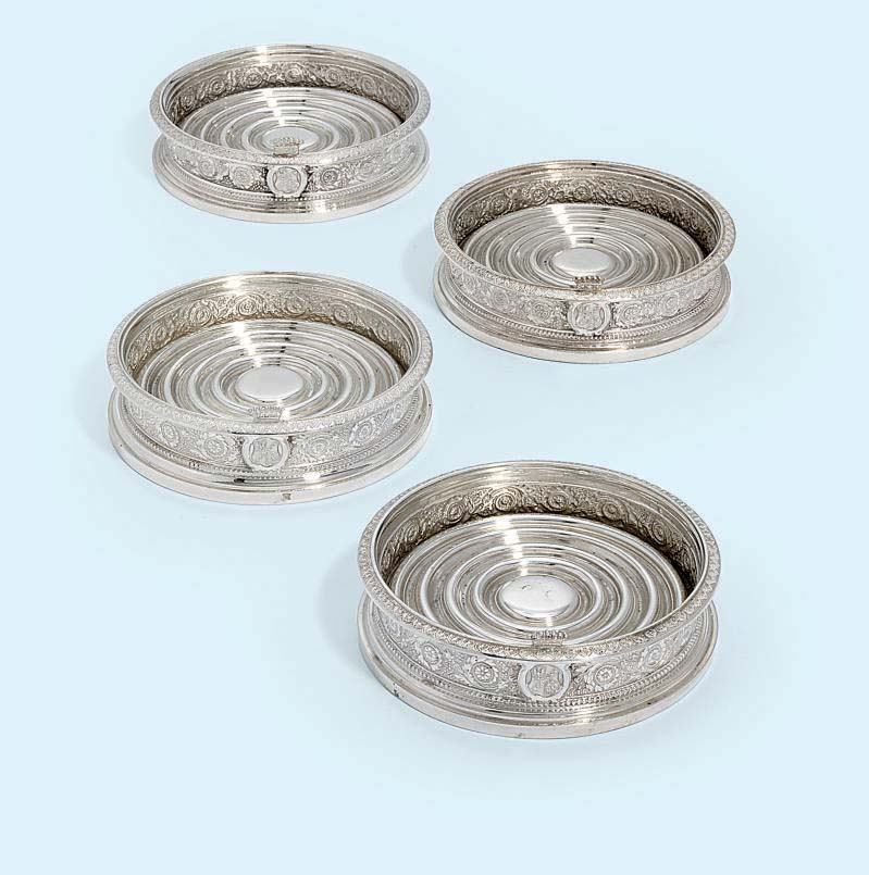 A SET OF FOUR AUSTRIAN SILVER WINE-COASTERS