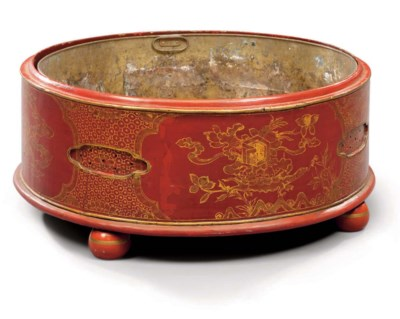 A RED AND GOLD LACQUER CIRCULA