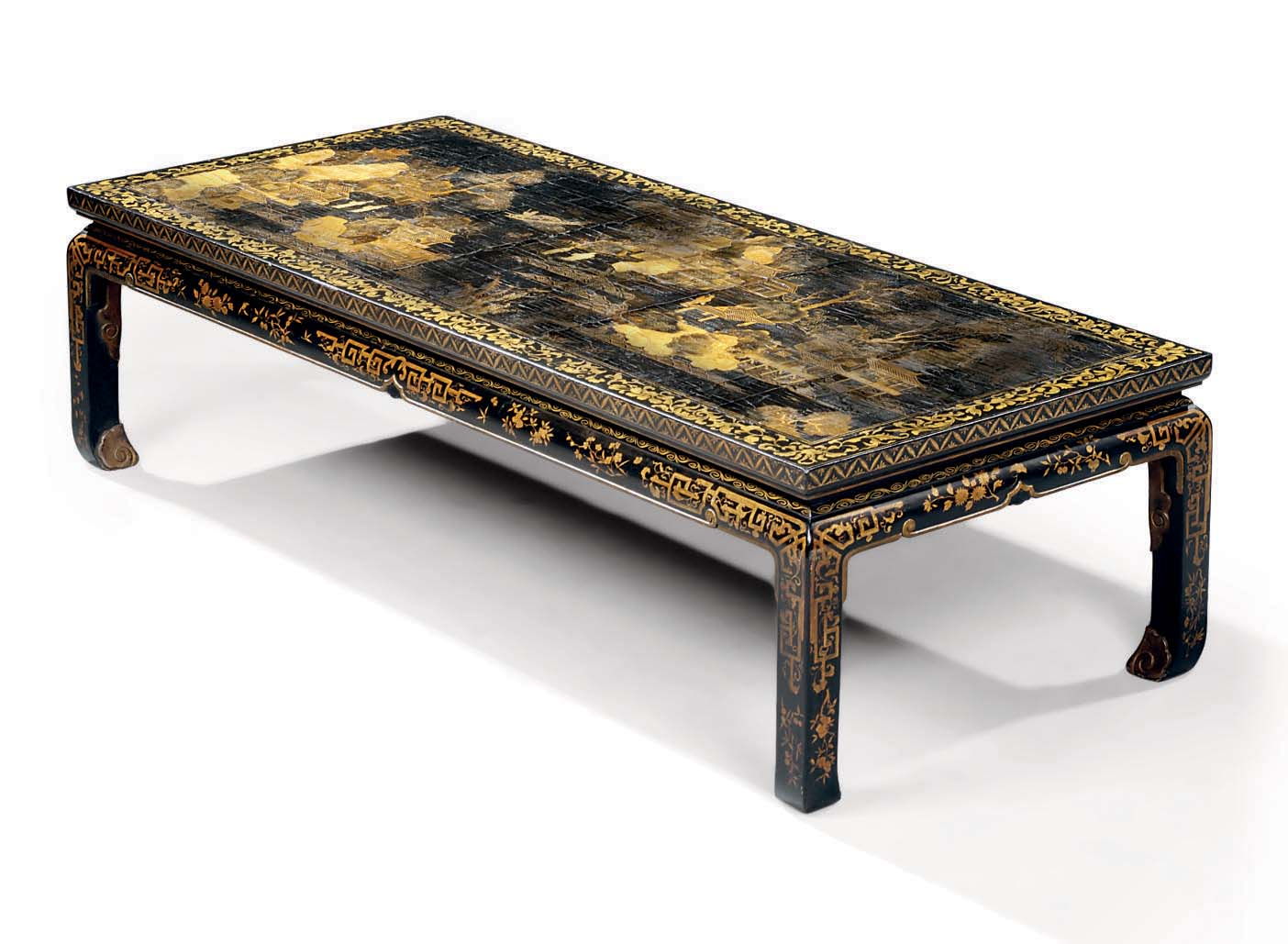 A BLACK AND GILT-LACQUERED AND