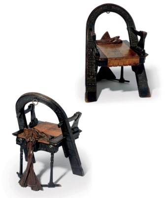 A Carved Stained Oak Trompe L'