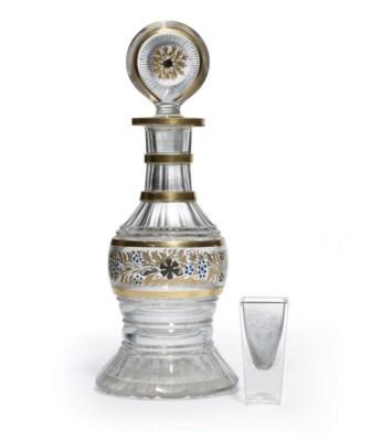 A Cut-Glass Carafe and Shot Gl