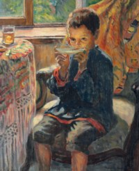A young boy drinking tea