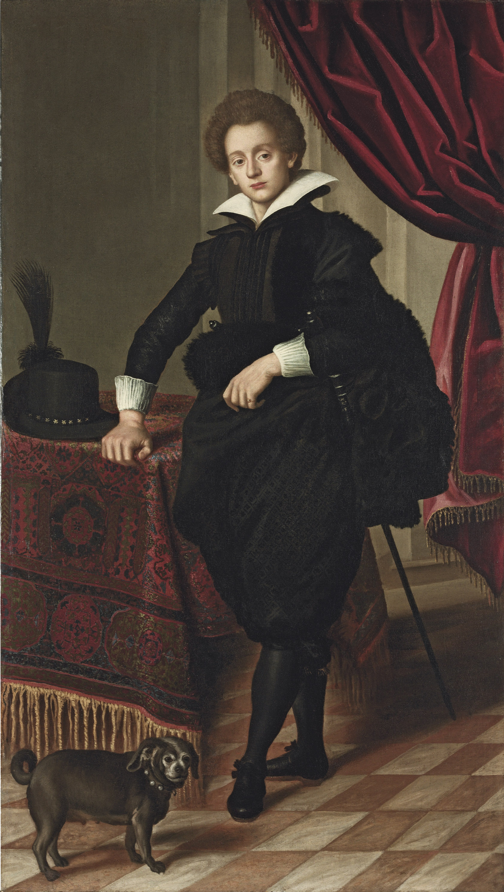 Portrait of a gentleman, possibly of the Strozzi family, full-length, in black doublet, mantle and pantaloons, wearing a sword, his hat on the carpet-draped table beside, with a draped curtain and a lap-dog