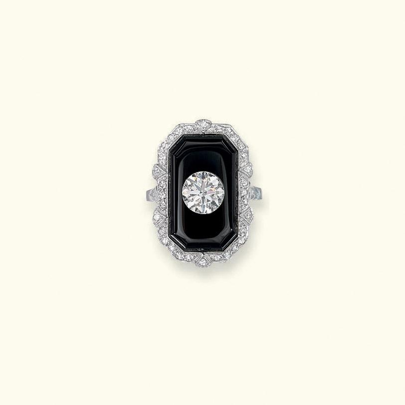 AN ART DECO ONYX AND DIAMOND R