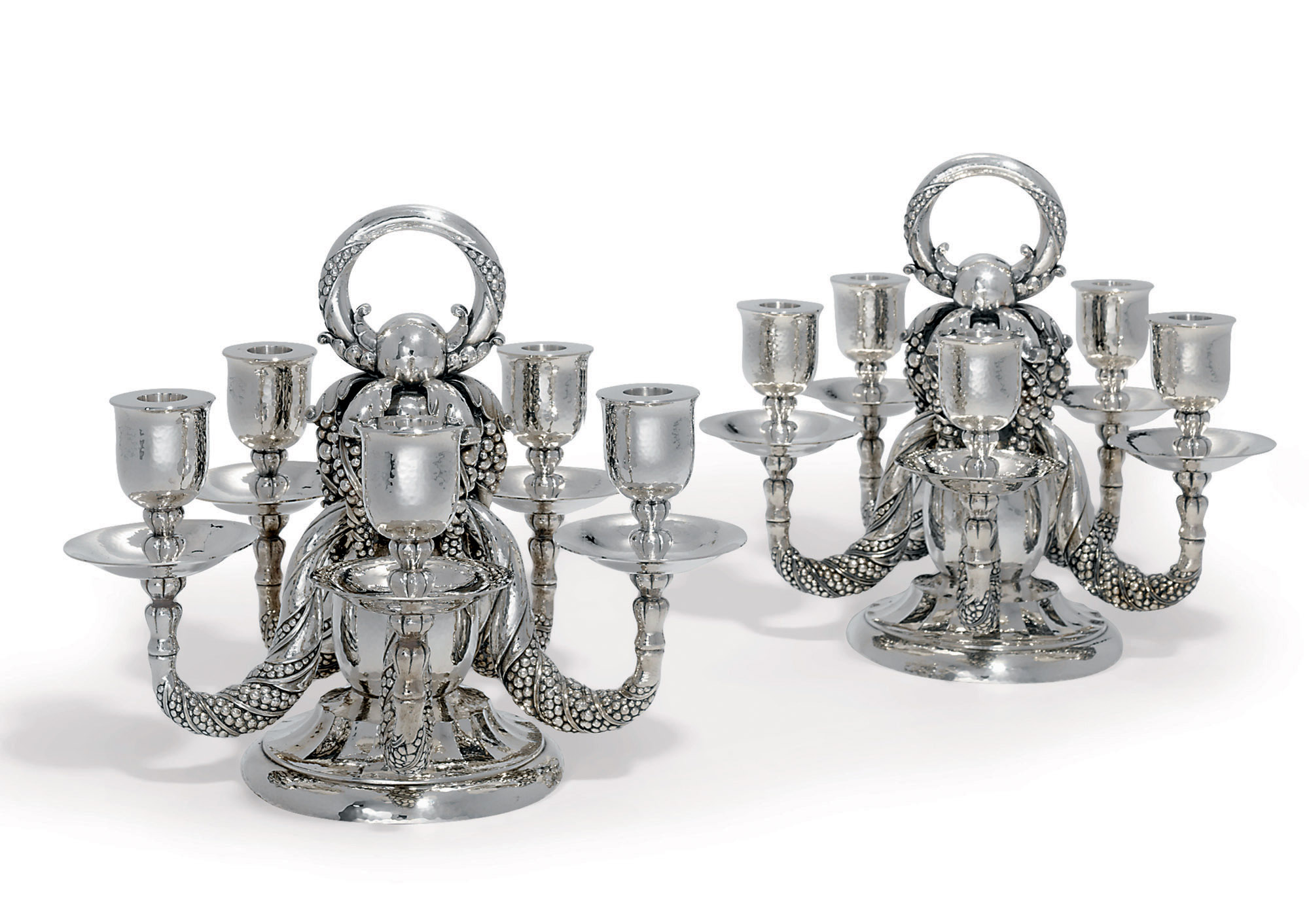 A PAIR OF DANISH FIVE-LIGHT CANDELABRA DESIGNED BY GEORG JENSEN