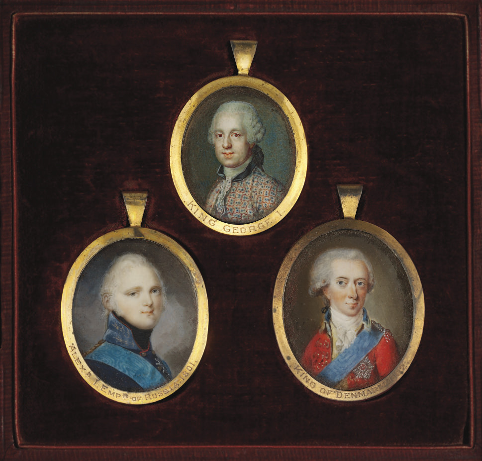 A FRAME CONTAINING THREE PORTRAIT MINIATURES