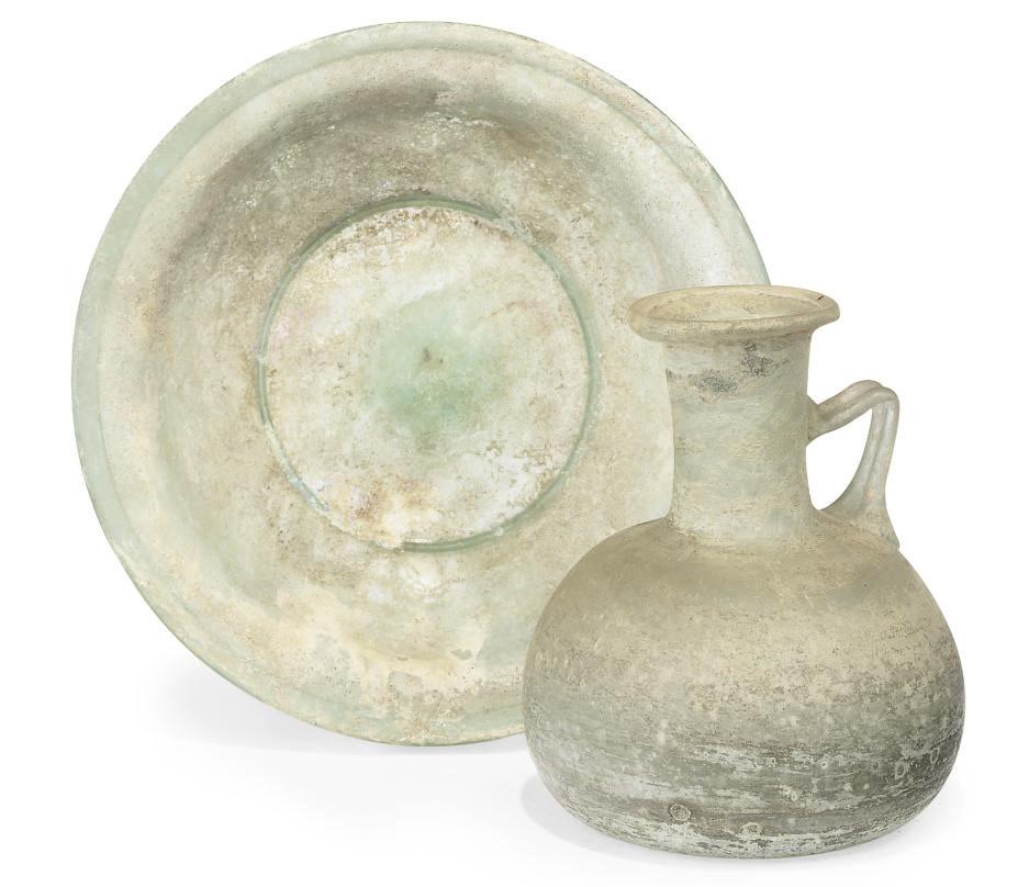 A ROMAN GREEN GLASS BOWL