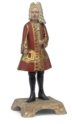 A PAINTED PLASTER FIGURE OF A